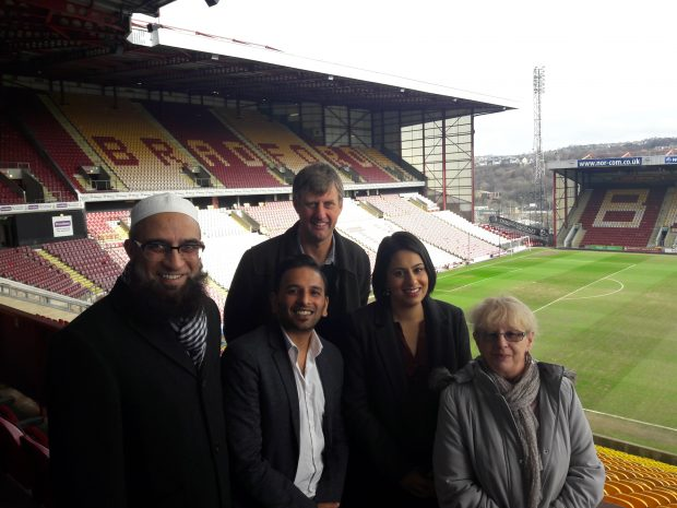 Picture of Sara Khan with four other people in a football stadium in Bradford