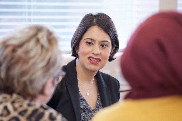 Lead Commisioner Sara Khan speaks to two women